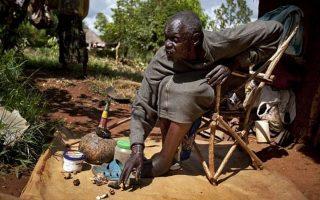 Kenyan witch doctor John Dimo. Nyang'oma Kogelo village 60 kilometers west northwest of Kisumu in Siaya County-Kenya Holidays