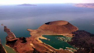Aerial Shot of Lake Turkana with South island in the back ground and Nabuyatom volcano in the foreground